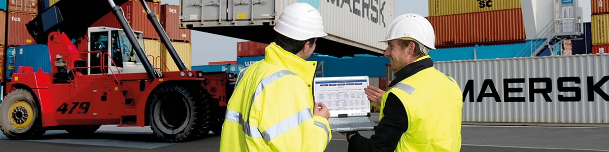 Logistics men in depot with tablet